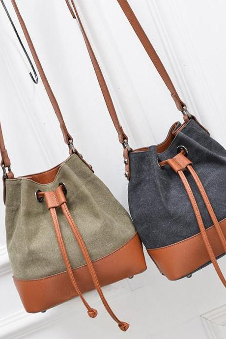 Leather and Canvas Bucket Bag with Adjustable Shoulder Straps